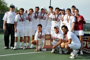 Mark Sandy and the men's tennis team celebrated the OVC championship in 2011.