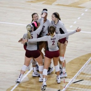 Volleyball team celebrates.